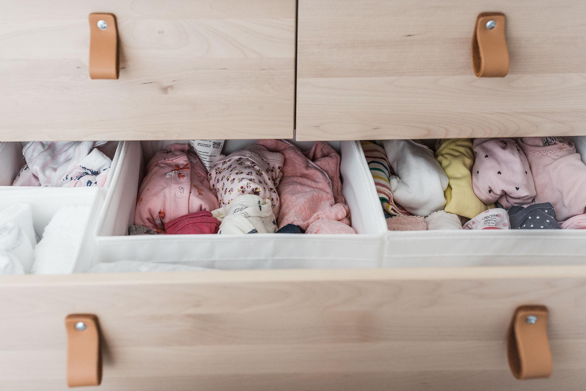 newborn's outfit in the dresser