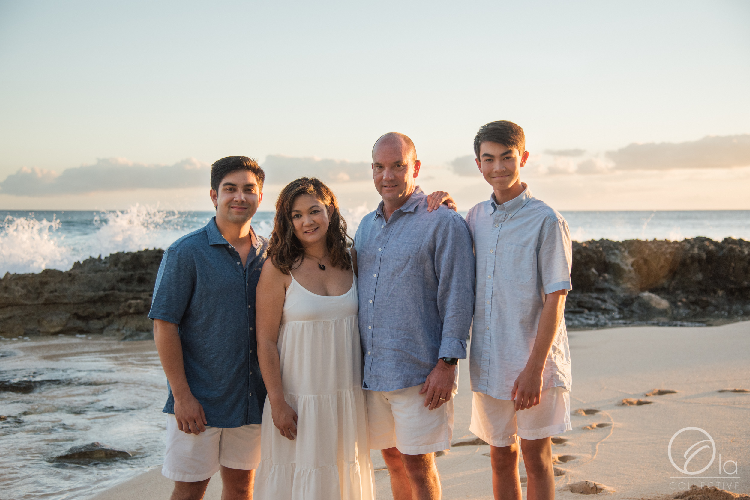 The waves crashing on the rocks behind them along with the soft golden sunset light made for a sweet family photo.