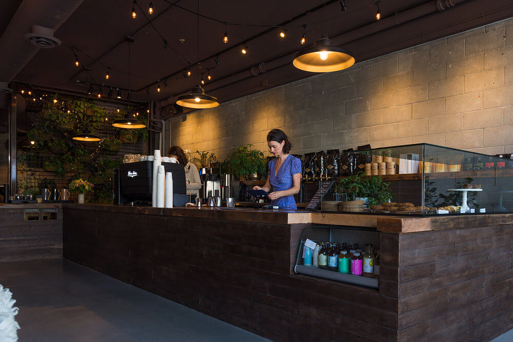 Stepping inside, The Garden's dark wood cafe bar welcomes you.