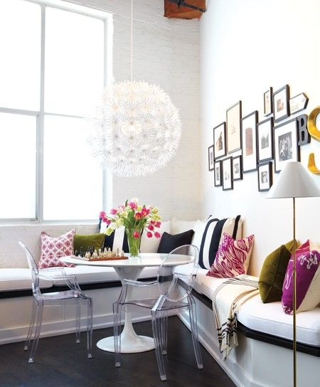 This fun and contemporary bench seating arrangement is basically made up of neutral color choices. The color comes in on the pillows, which makes it easy to change the color palette completely with out having to start completely over and save big by just replacing the pillow casing covers. This is smart design!