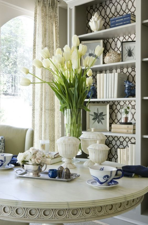 The final touches of accessorizing with books, bowls, candles, flowers, pictures, and other elements can have a huge impact in making a room look beautiful and finished looking.