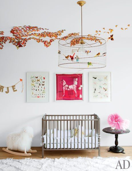 Here is a bright and cheerful child's room. Notice the soft area rug for the baby to play and crawl on. Love that they included nature thru adding birds and butterflies that gives this organic design a warm and relaxing feel.