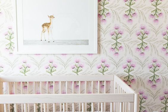 Another example of wallpaper adding depth and interest into this babies room. This crib and picture are simple and compliment the patterned wallpaper.