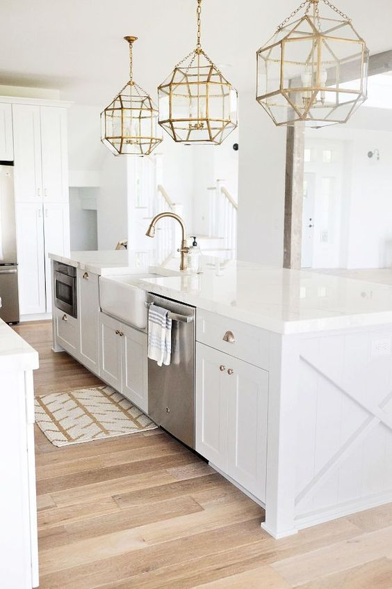 Love warm light wood floors with white cabinetry. Gold accents in lighting and hardware are big now. The gold accents bring a modern element to kitchens and make them more appealing to look at.