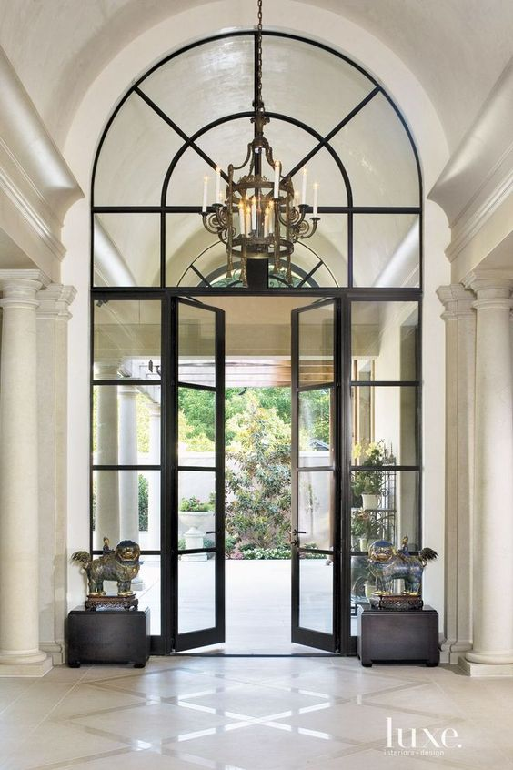 Gorgeous entryway with a lot of impact thru symmetry makes a huge statement. Pillars, windows, doors and foo dogs lead the eye outside!