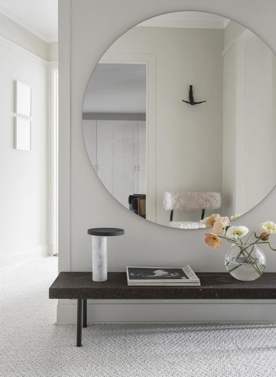 In this entry is has a very feng shui feel to it with the very low bench and a clean lined mirror. This space is very peaceful, calm and restful and the sitting area invites you in by all the carefully selected objects