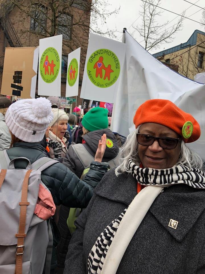 Sarah Dean (staff) marching in the 2018 Women's March