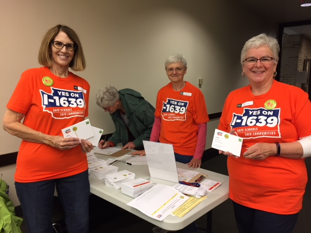 Sending out postcards to encourage voters to show up for I-1639