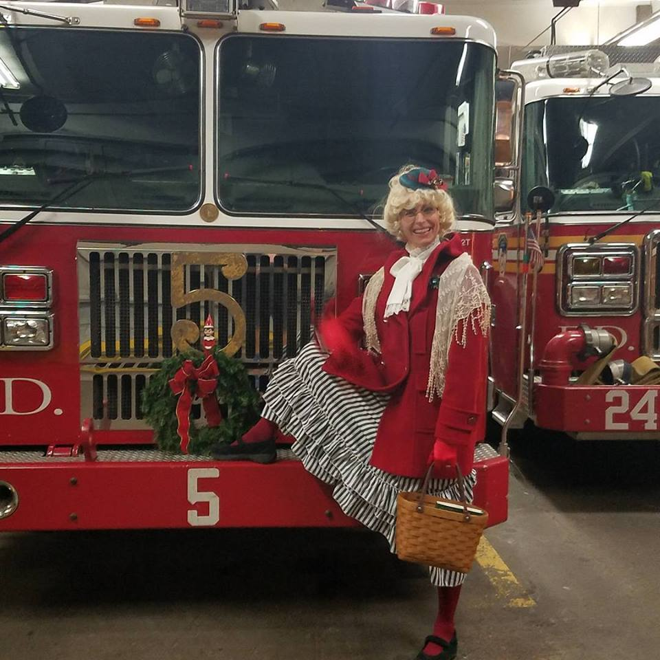Here's me (Mrs. Claus) stopping at the Fire House in the West Village on Christmas Eve night.