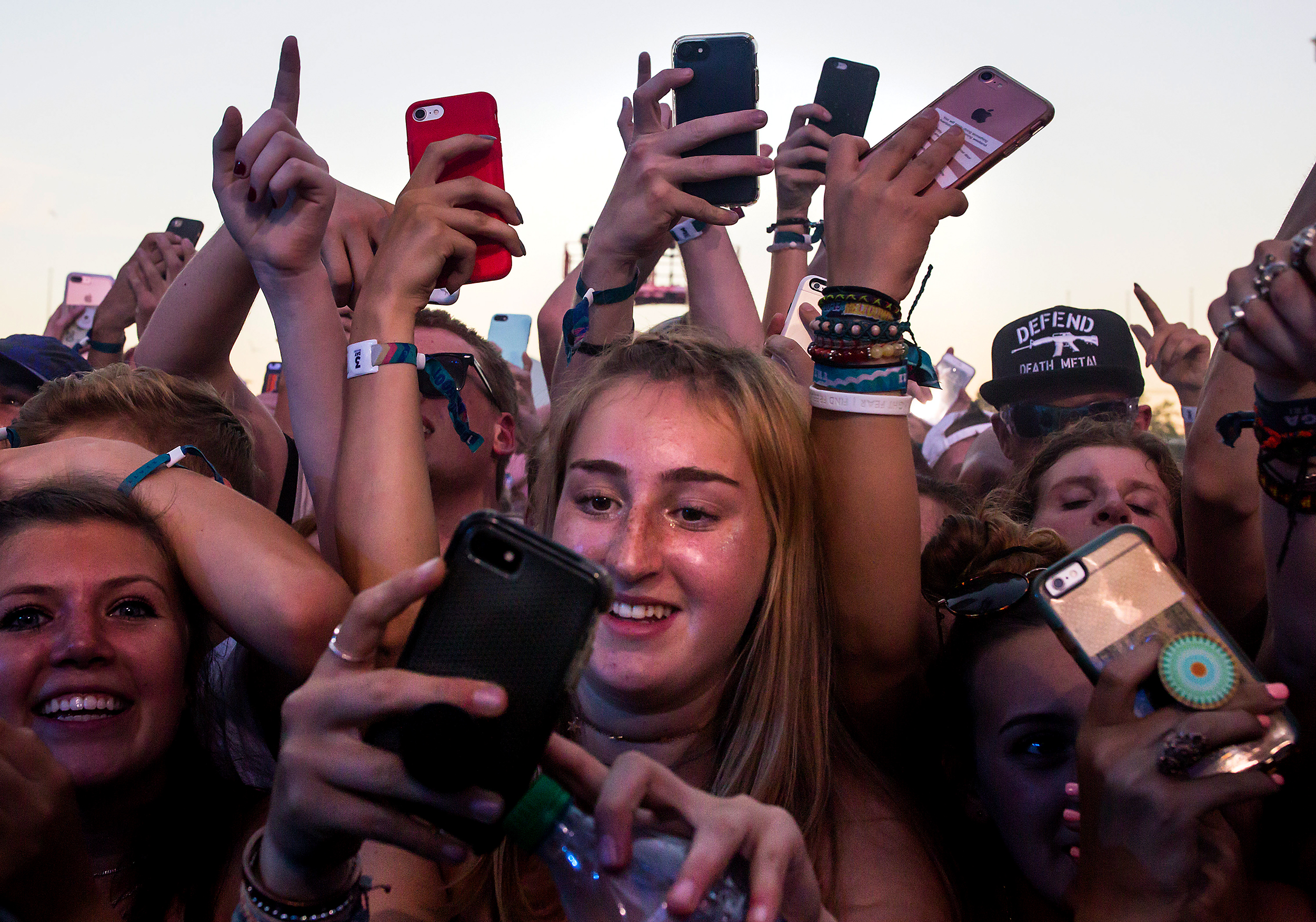 Young fans grip their iPhones as they wait for Foster the People to perform at Bumbershoot, Friday, Sept. 1, 2017. (Sy Bean / Seattle Refined)