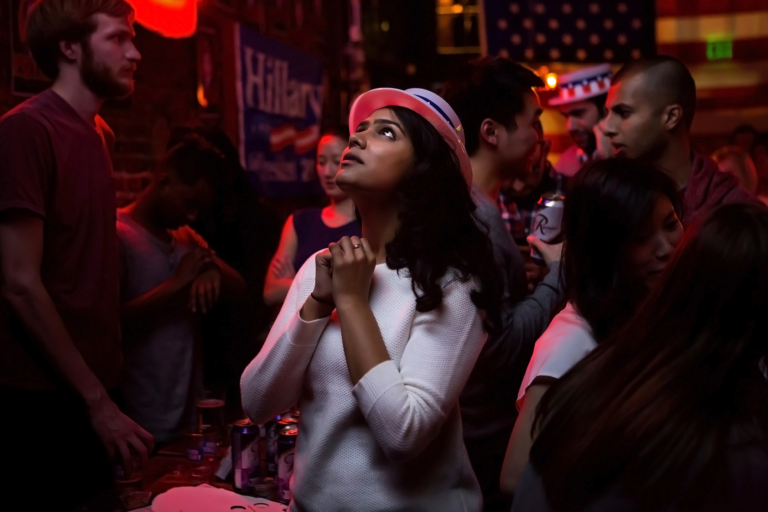 """Sri Vasamsetti, 22, reacts to presidential candidate Donald Trump's progress in the swing state of Florida during an election viewing party at the Comet Tavern in Seattle's Capitol Hill neighborhood, Tuesday, Nov. 8, 2016. """"It's terrifying to watch the map turn red,"""" Vasamsetti said. (Sy Bean / The Seattle Times)"""