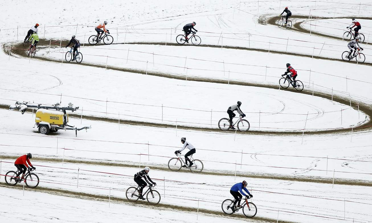 After climbing hills and racing through forests, riders near the finish line during the 2014 UCI Carousel Volkswagen Jingle Cross Rock at the Johnson County Fairgrounds in Iowa City on Sunday, Nov. 16, 2014. The event raised funds for the UIHC Children's Hospital. (Sy Bean / The Gazette)