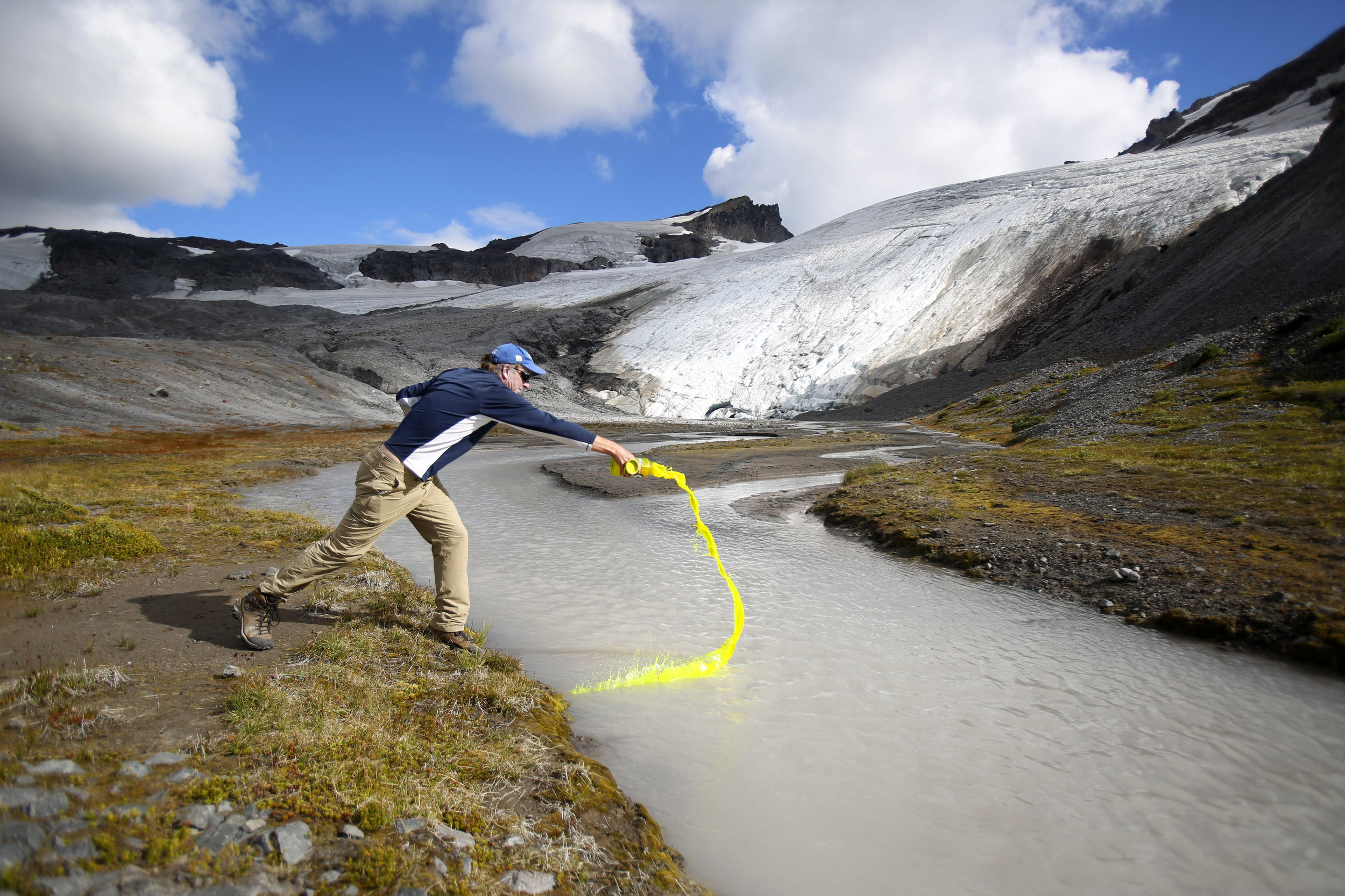 Glaciologist Mauri Pelto pours biodegradable dye into a runoff stream Friday, Aug. 7, 2015, in order to measure the volume of runoff on Sholes Glacier, on the northeast slope of Mount Baker. The glacier has receded more than 90 meters, or nearly 300 feet, Pelto said.