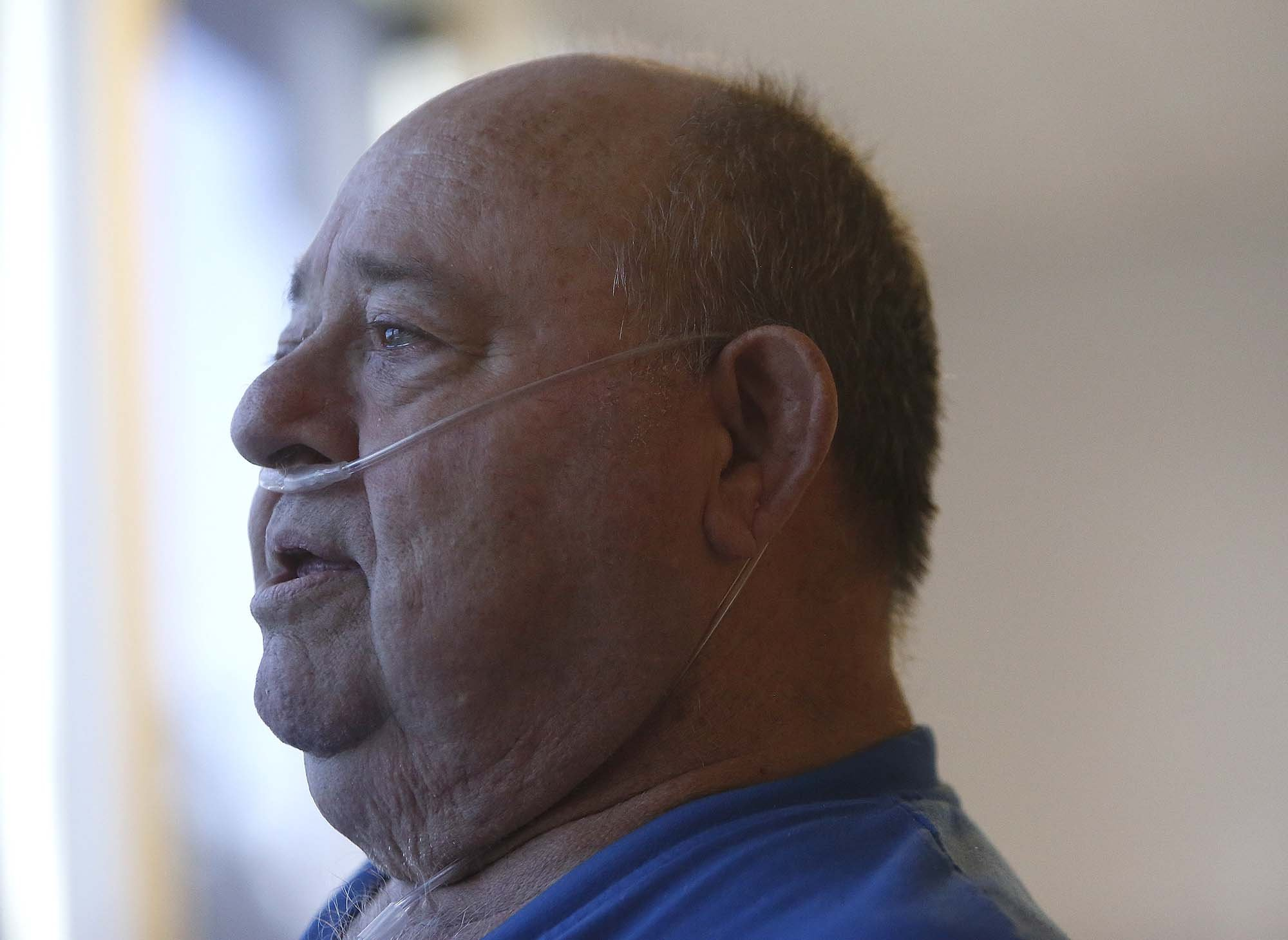 Retired school teacher and evacuee from Twisp, John Lewis, waits out the wildfire and for air quality conditions to improve at the Brewster Community Center in Brewster, Wash., Friday, Aug. 21, 2015. Lewis has Chronic Obstructive Pulmonary Disease, and remains indoors until air quality conditions improve.