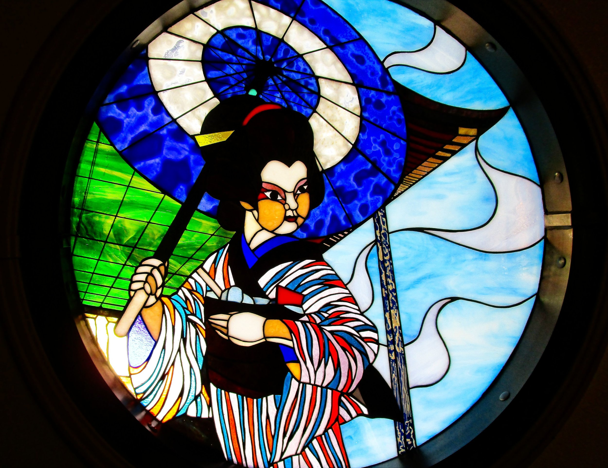 Stained glass window inside a restaurant on the main thoroughfare to the temple