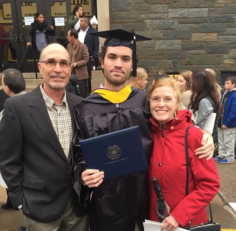 Henry Jones with his parents as he graduates from West Chester University.