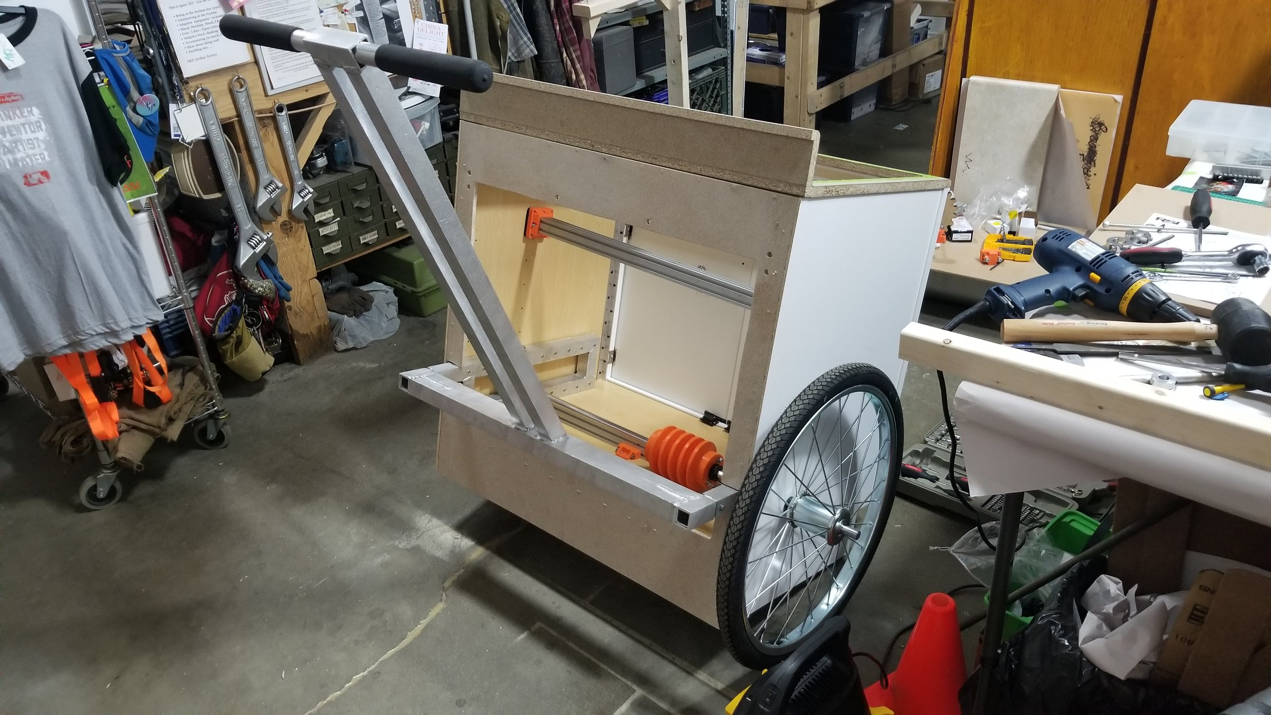 With the handlebar installed and the wheels on the side. The area where the main axle sits determined the rest of the placement.