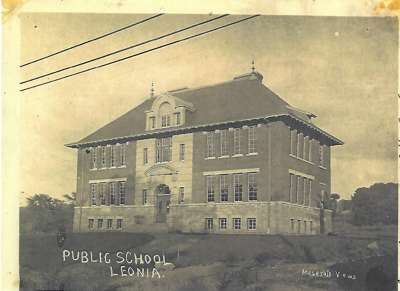 Broad Avenue Elementary School circa 1906 - However, there were not enough students in Leonia to economically operate a high school. By inviting pupils from the surrounding communities on a tuition basis, the Borough raised sufficient funds to purchase land and construct a building on Christie Heights Street. Leonia High School was completed in April of 1913.Broad Avenue elementary school 1906 (postcard collection)