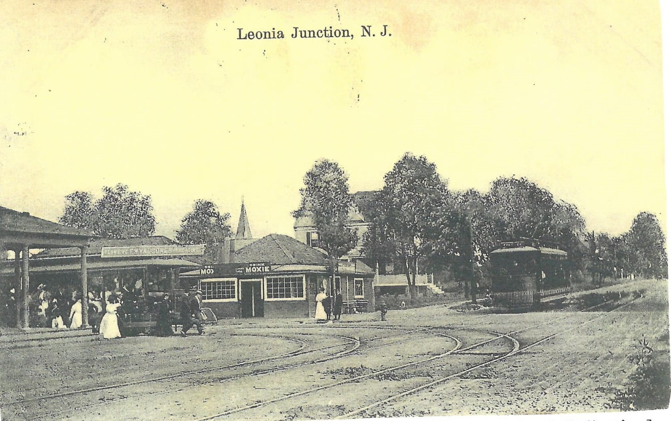 Trolleys at Junction circa 1914 - With the arrival of the trolley in 1896 the town center moved up to Broad and Hillside Avenues and came to be called the Junction. Leonia was no longer a rural agricultural town. The trolley line to the 125th Street Ferry was extended in 1900 down Broad Avenue. The West Side Subway completed the links, making New York City accessible. A developer named Artemus Ward created the Leonia Heights Land Company in1899. He advertised his cultural mecca on New York subways as the Athens of New Jersey. Ward's efforts brought large numbers of people to Leonia.(Althea Eames Oliver Postcard Collection)