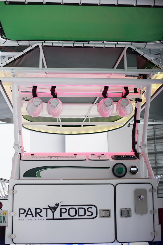 Rear fin provides sun protection for service area.
