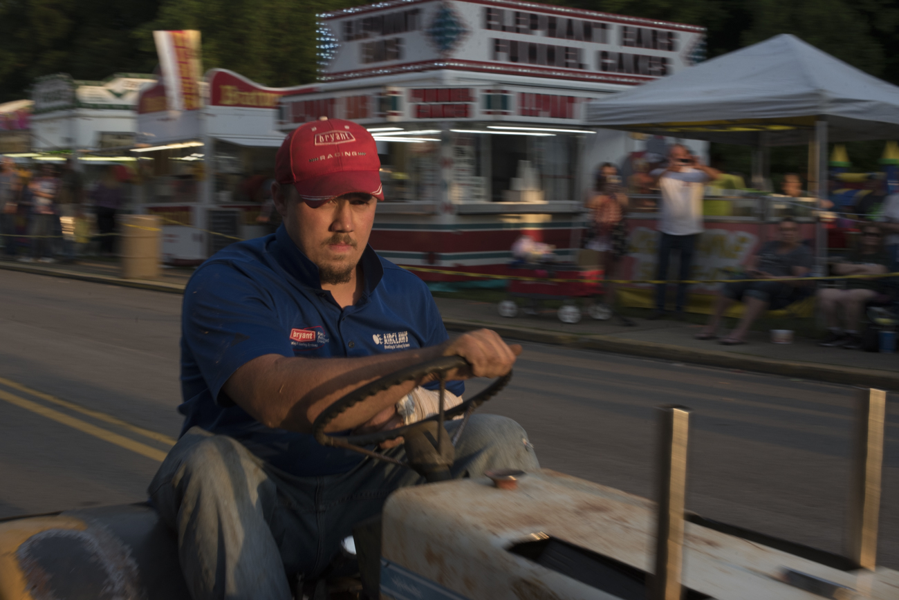 Don Beavers rides his tractor through the New Straitsville Moonshine Festival
