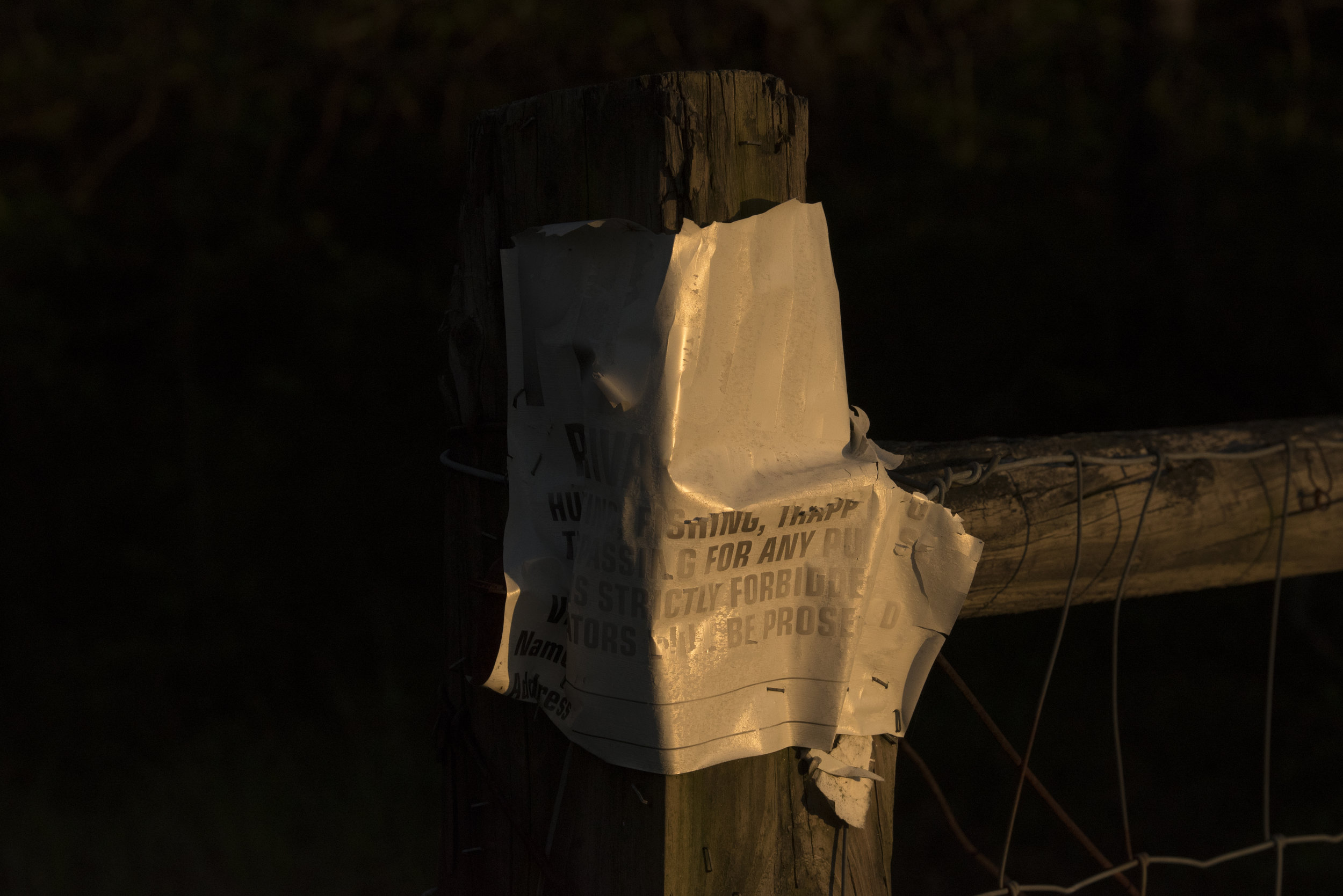 A worn sign hangs on a post in Pike County, Ohio