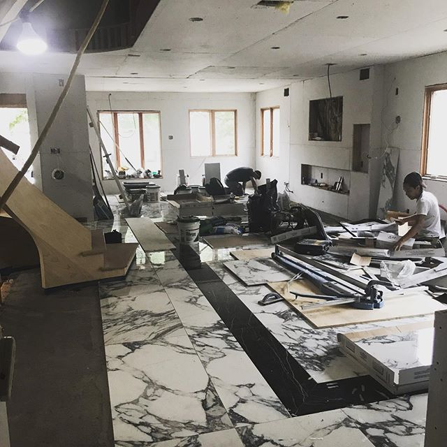 Installing large tiles for dining room floor with border, coming soon , railing, lighting, paint. This room will look great @jbuildersny