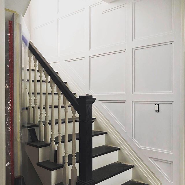 Creating squares of double molding in hallway and painting satin white finish #modern #moldings #brooklyncontractor @jbuildersny