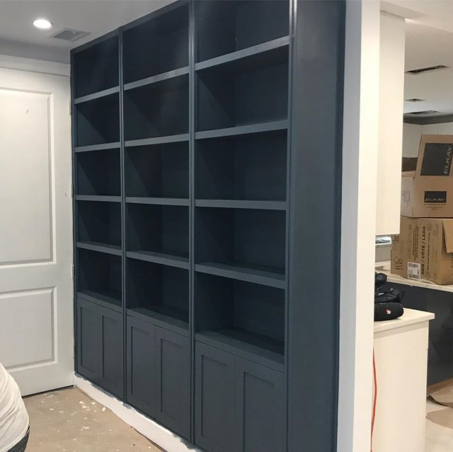 Custom book shelf in den, built to size, paint finish.