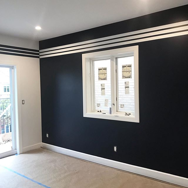 Painted walls detonator white, navy accent wall, with white stripes and the reverse blue stripes on white wall. #accentwall #painting @jbuildersny