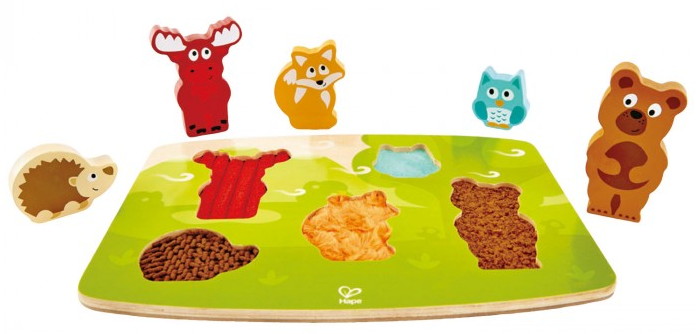 """This """" Forest Animal Tactile Puzzle """" by Hape combines the fine motor skills of a chunky wooden puzzle with sensory exploration. Children can feel the coats of each animal underneath each piece."""