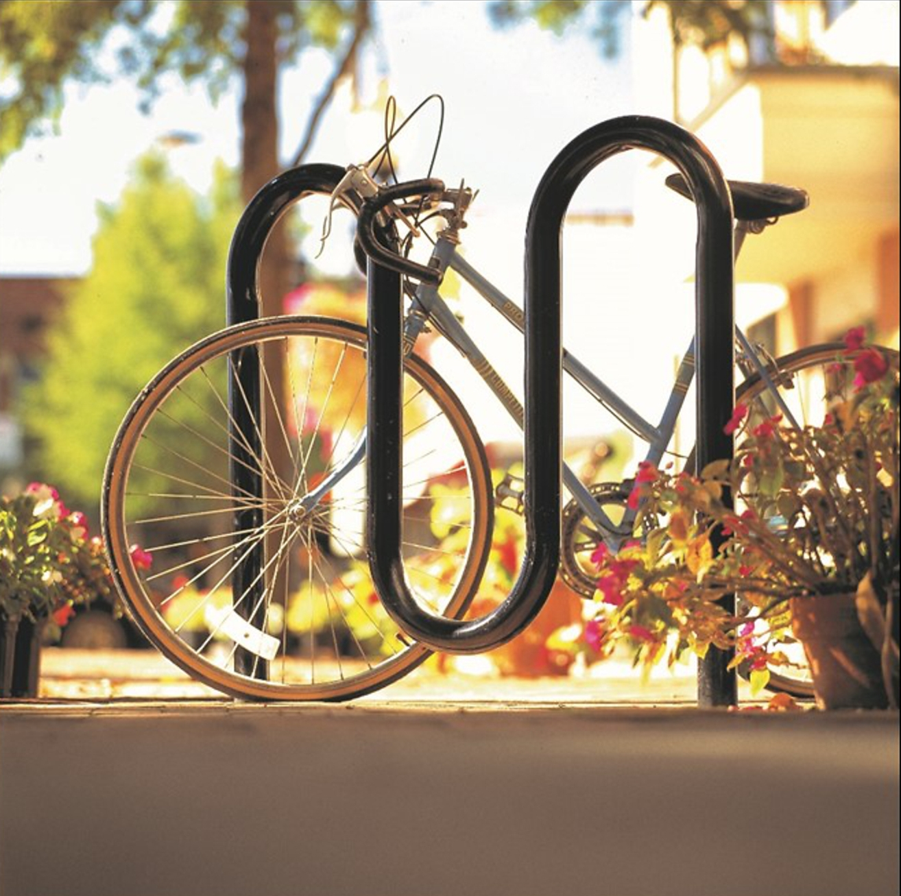 Bike Racks   In-ground, surface and portable racks available in many styles and options.