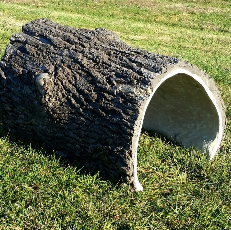 Crawl Thru Log     Dimensions: 48″ x 36″ x 30″   Age Group: All   Color: Natural Oak    This crawl-thru log with authentic bark re-creation is the perfect tunnel for your natural-themed playground. Use one or multiple to create a unique play space for children of all age groups.