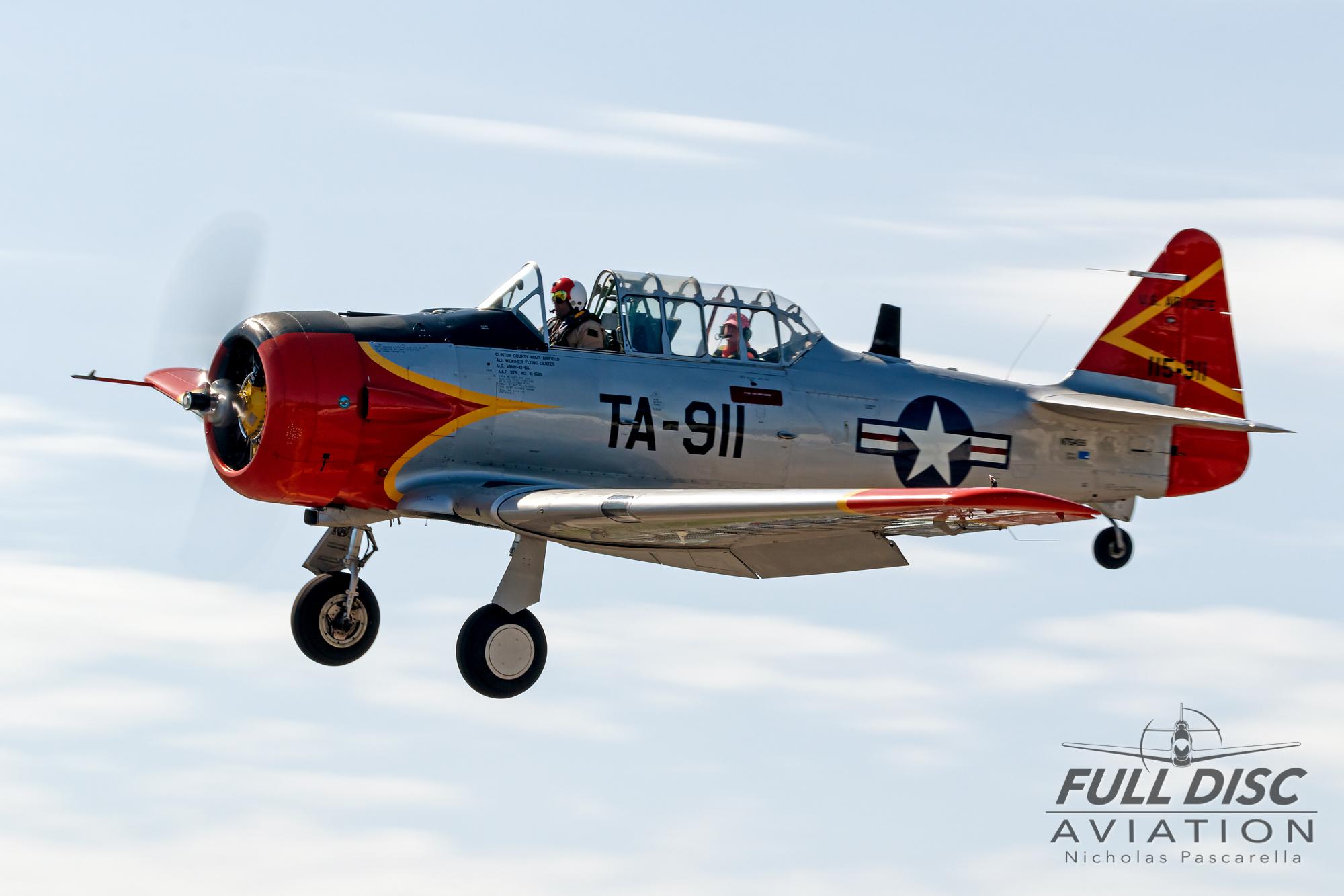 americanairpowermuseum_nicholaspascarella_nickpascarella_fulldiscaviation_legendsofairpower2019_aviation_warbird_t6_texan_landing_red.jpg