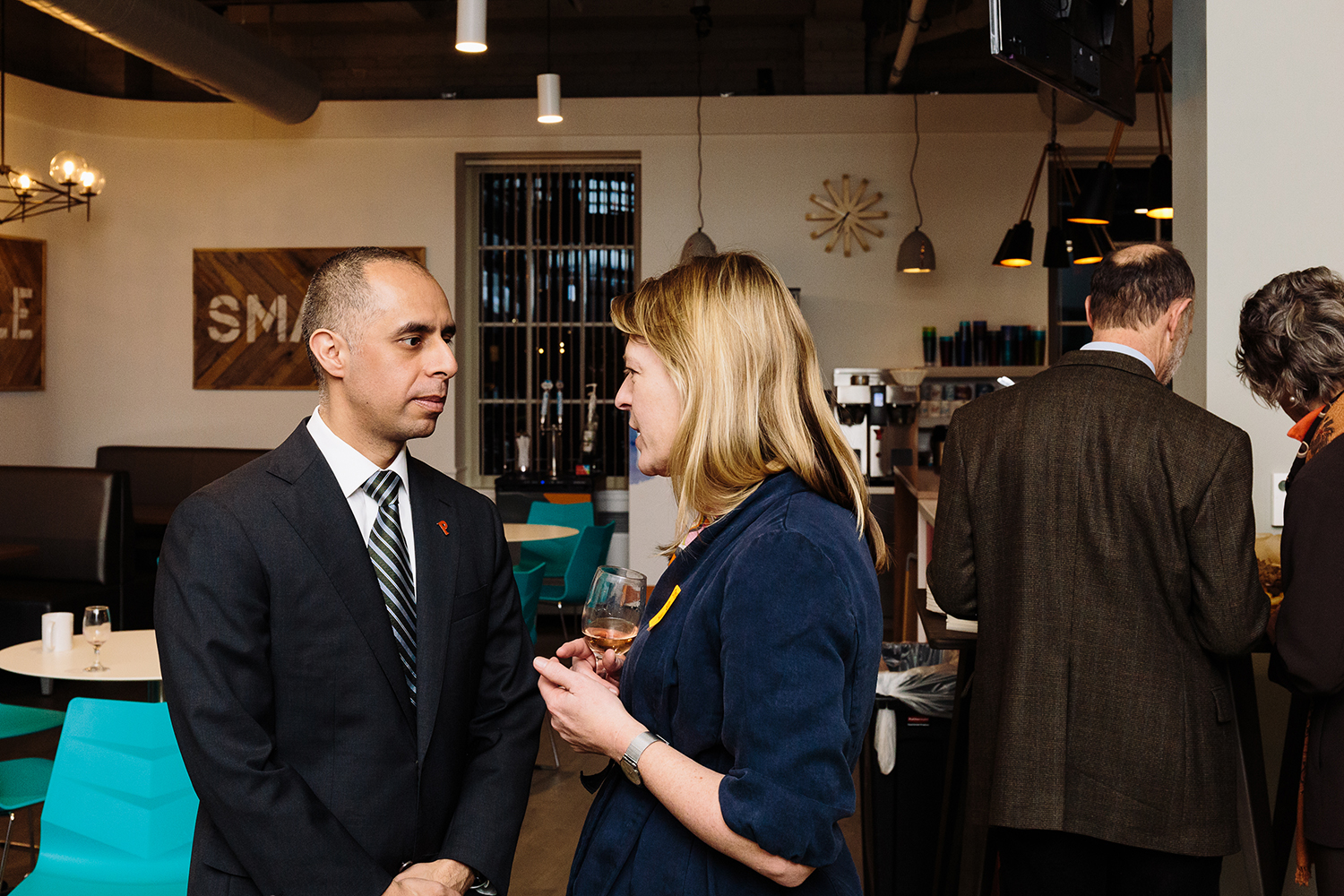 Providence Foundation member speaks with Mayor Jorge Elorza.