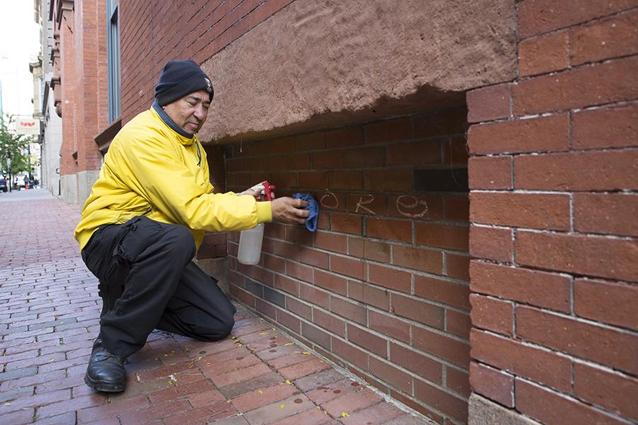 DID ambassador cleaning graffiti