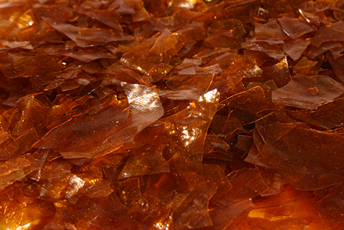 Photo:  Red shellac flakes