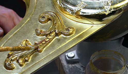 Photo: Applying shellac base coat before oil gilding