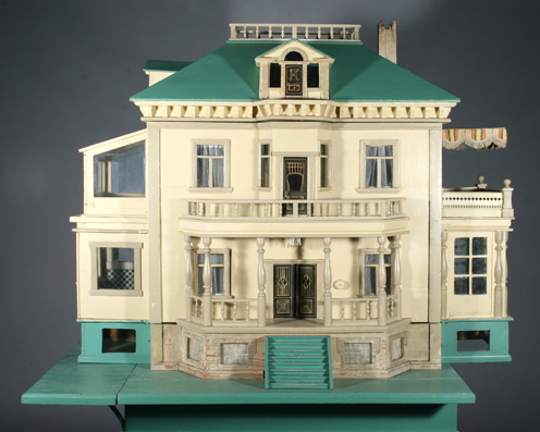 Photo:  Wooden dollhouse after restoration