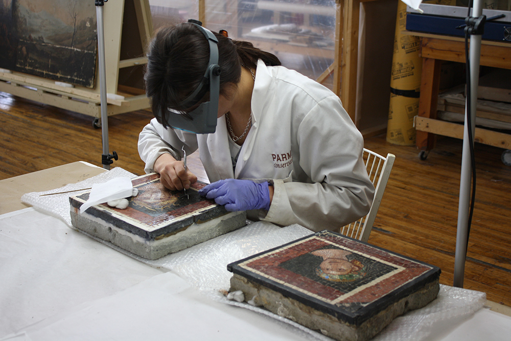 "Photo:  Two ""Allegorical Heads"" during conservation"
