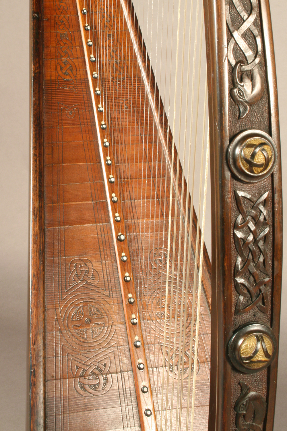 James McFall harp with wood-carved patterns