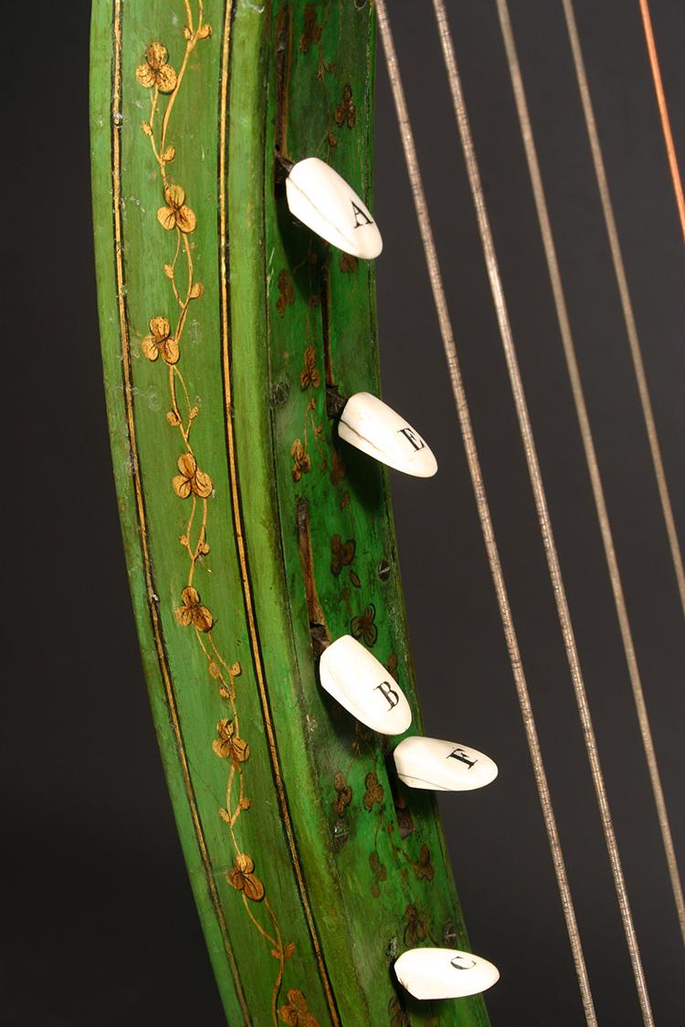 Historic John Egan harp with gold shamrock detail - peg close-up