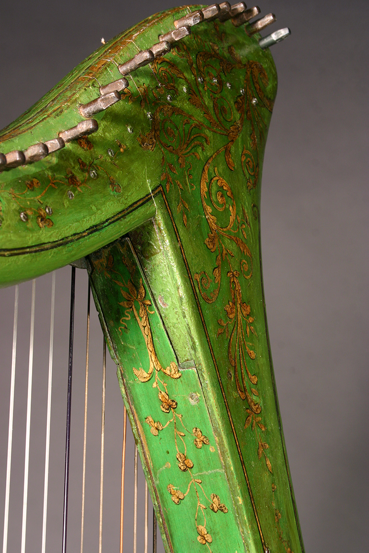 Historic John Egan harp with green and gold polychrome surface decoration