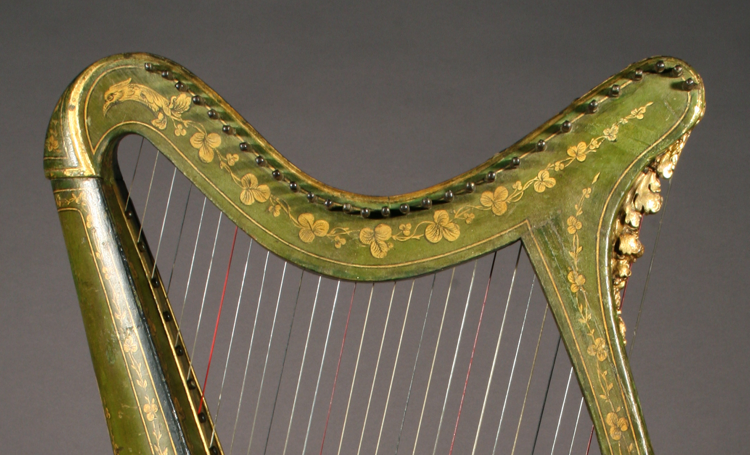 Historic Irish harp with polychrome painted details and gilded carved motifs
