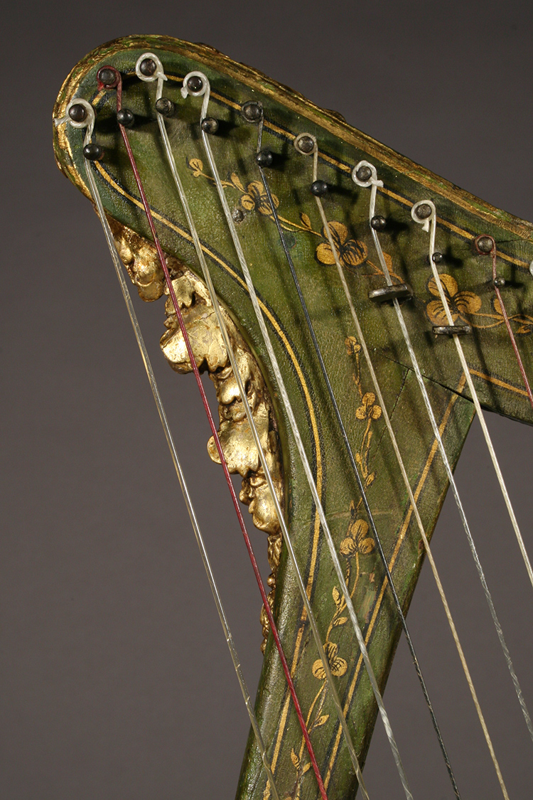 Historic Irish harp with polychrome details - close-up gilded carving