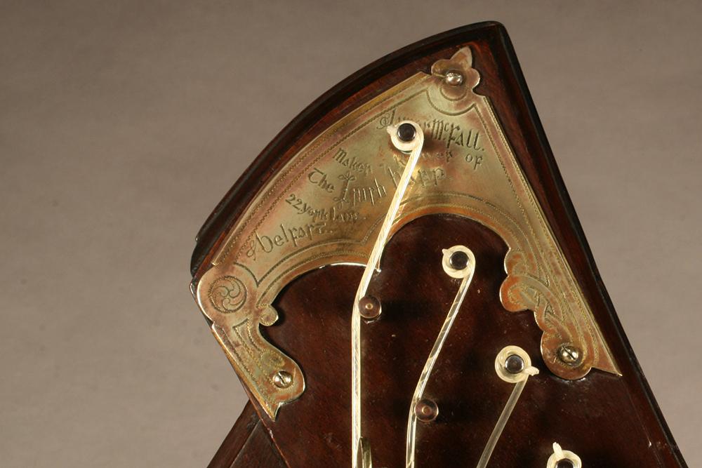 "James McFall harp with copper-alloy plate saying, ""James McFall / Maker Reviver of / the Irish Harp / 22 York Lane / Belfast"""