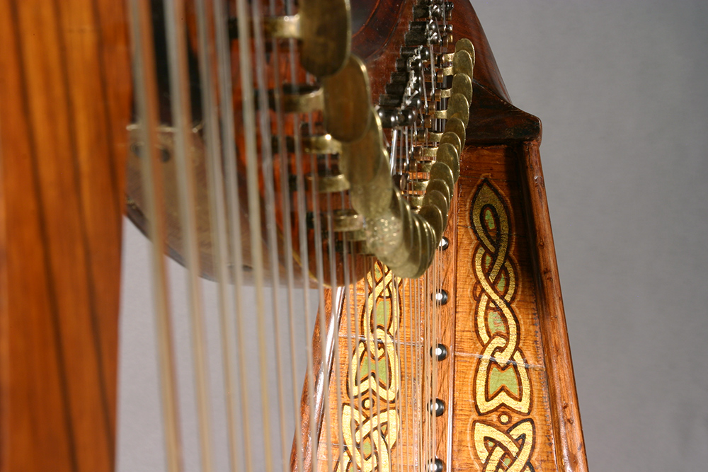 James McFall harp with with gilt, green, and black polychrome designs restored at Bernacki & Associates, Inc.