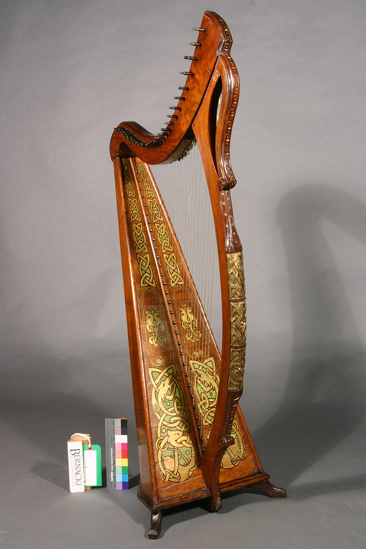 James McFall harp displaying rich gold, green and black polychrome design