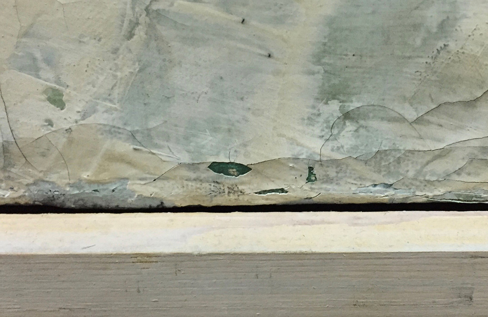Areas of paint loss resultant from cleaning of an unstable paint layer