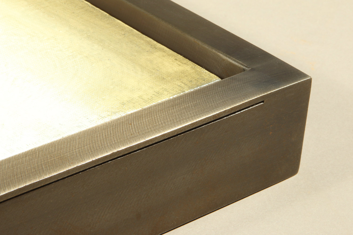 """This sophisticated custom welded float frame features elegant thin groove that contrasts with edge thickness. Rather than a narrow width, the frame was designed to have a ½"""" face, to add more prominence to both the frame and the art piece."""
